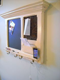 An  iPhone Dock on a FitzWoodys Furniture Wood Framed Cork Bulletin Board or Chalkboard with Mail Slot, Keyhook. I think this is a great idea, the only problem is hiding the power cable.
