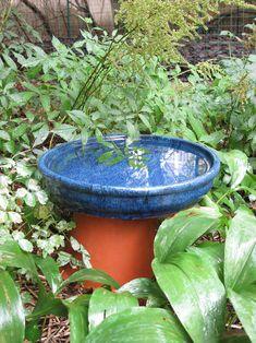 "Use terra cotta pots for an easy bird bath in the garden. I really like how this one is ""hidden"" Ceramic Bird Bath, Diy Bird Bath, Ceramic Birds, Lawn And Garden, Garden Art, Garden Ideas, Terra Cotta Bird Bath, Easy Bird, Wood Planter Box"