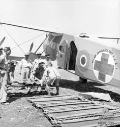 Sicily, Italy. September 1943. Wounded British soldiers being prepared for evacuation in a DH86 aircraft of No. 1 Air Ambulance Unit Royal A...
