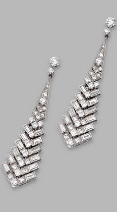 PAIR OF PLATINUM AND DIAMOND PENDANT-EARRINGS, CIRCA 1925 The articulated pendants of graduated design set with round, single-cut, old European-cut and baguette diamonds weighing approximately 6.75 carats, with later added tops.
