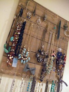 """another angle of the jewelry holder :) specs: 4 - 1 x 4's and 2 - 1x3's 18"""" long, flat brackets to screw the pieces together on the back (using one bracket as a spacer), 3/8"""" cup hooks (18 per row for the necklaces 1/2"""" in from each edge and 1"""" apart --and one on each end of some chain for hanging earrings).. a little stain and furniture wax before assembly.."""