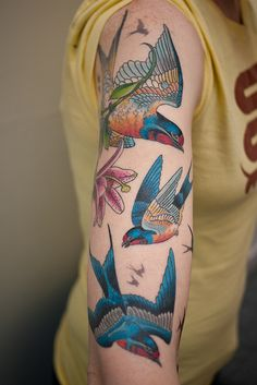 Vibrant colors make for some damn good bird tattoos.