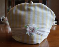 Shabby Chic Yellow & White Stripe Print Insulating Fabric Tea Cosy / Cozy with Swag, Crocheted Flower and Custom Polymer Clay Bead Pull Top by TeaWithFriends on Etsy $50.00 CAD