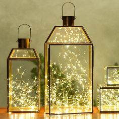 Wrap twinkle lights in a glass lantern to create a unique light fixture.