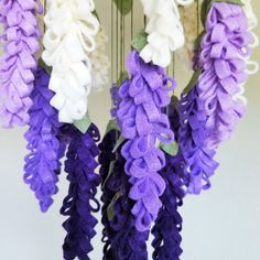 ♥ The Original Wisteria Chandelier mobile includes 5 deep purple, 6 violet, 6 lilac, and 8 cream wisteria blossoms as well as 40 olive green leaves ♥ Each flower and leaf is hand-cut from eco-friendly felt and hung with olive green embroidery thread from a steel ring 8 in diameter