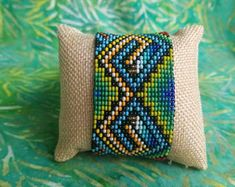 Items similar to Guacamayos/Macaw Thick Bracelet- 31 bead (Colombia) on Etsy Beaded Bracelets, Throw Pillows, Traditional, Beads, Creative, Handmade, Inspiration, Etsy, Design
