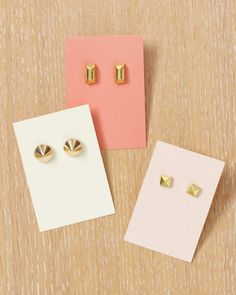 Earrings  These earrings are so easy and inexpensive to make, you can make a few pairs for yourself and a few pairs to give away!     Tools and Materials Studs Earring posts Chipboard Superglue Round needle-nose pliers