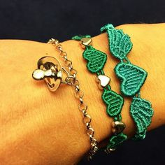 "Cruciani Hearts by Helena Bordon (in cobalt green) and Angel Heart (in ""flag"" green) bracelets"