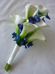 This is a gorgeous color/flower mixture as well. Calla lillies with blue orchids.