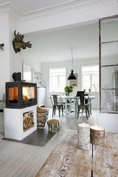Love the window divider separating the two rooms & that fireplace.