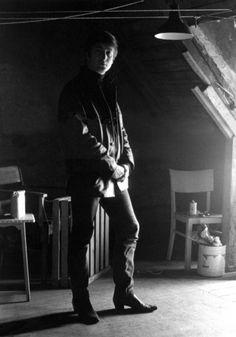 a standing John Lennon in Stuart Sutcliffe's art studio at Astrid Kirchherr's house, 1962