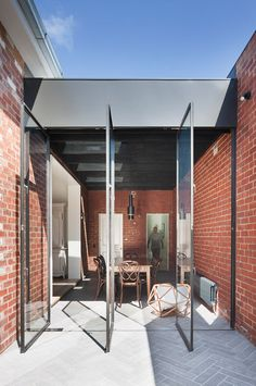 Melbourne studio Clare Cousins Architects rearranged and extended a Victorian house in the city's St Kilda East district to create two wings for living and sleeping.