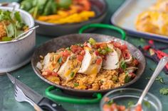 FIESTA LIME CHICKEN is our favorite easy grilled Summer meal! Served on a bed of Mexican rice and topped with lime ranch, pico de gallo, and tortilla strips; this flavor can't be beat!