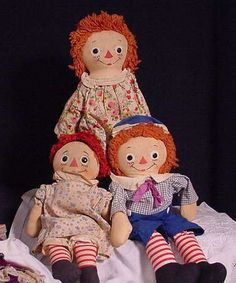 A Group Of Three Vintage Raggedy Ann and Andy Dolls - larger Ann & Andy are tagged Georgene