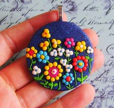 Colourful and happy medallion, full of blossoms and lovely magical flowers out of a fairy tale :)  This medallion is made from fimo polymer clay, has