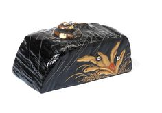 A LACQUERED-WOOD AND METAL NETSUKE By Yokobue, 19th century Sold for £ 4,375 (US$ 6,152) inc. premium THE EDWARD WRANGHAM COLLECTION OF JAPANESE ART Part III 15 May 2012
