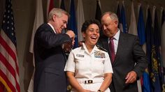 Female four-star general: Michelle Howard: Secretary of the Navy Ray Mabus, left, and Wayne Cowles, husband of Adm. Michelle Howard, put foufour-star shoulder boards on Howard's service white uniform during her promotion ceremony at the Women in Military Service for America Memorial July 1, 2014 in Washington...