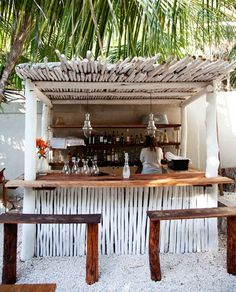 No idea where this beach bar is but it looks awesome.