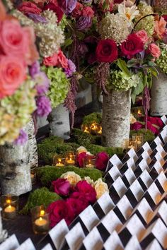 Log vases for whimsical, rustic centerpieces.  Mel Barlow Photography