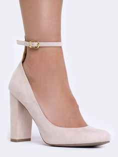 - For trendsetting appeal slip on these ankle strap heels! - Vegan suede pumps have a slightly rounded toe with a block heel. - Non-skid sole and cushioned footbed. - Color- Nude Suede - Synthetic upp