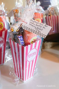 Plastic popcorn boxes make the cutest take home gift. We filled ours with microwave popcorn red box certificate and yummy movie candies. Backyard Movie Party, Outdoor Movie Party, Backyard Movie Nights, Farm Party, Backyard Birthday, Movie Night For Kids, Movie Night Party, Music Theme Birthday, Birthday Party Favors
