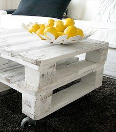 Pallet board coffee table in the perfect weathered white. Attached wheels and boom :)