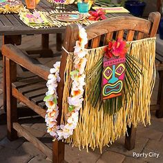 Want to create this DIY chair decoration? All you need is a child's grass skirt, a tiki paper cutout and a hibiscus hair clip! Grab everything you need by clicking through.