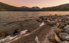 Peach and pink dusk colors over June Lake in Mono County, CA.