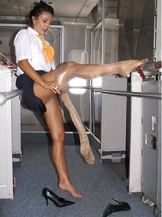 pantyhoseheadquarters:  Flight attendant putting on pantyhose.