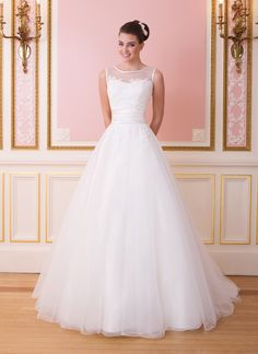 Sweetheart Gowns sweetheart style 6007 This illusion Sabrina neckline is trimmed in satin and the bodice is adorned with lace appliques. A pleated cummerbund cinches the waist of this tulle and lace ball gown. Tulle buttons cover the back zipper and ends in a chapel length train.