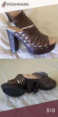 Eye Catching! Eye catching, strappy shoes will get you around town in fashion. Look at the indescribable details. 4' heel feels like 3 1/2' with the platform. Like New! Shoes