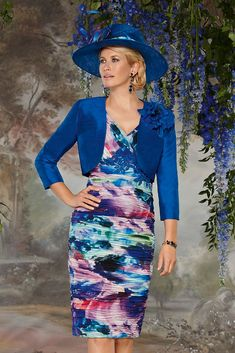 11285 (Condici) Printed dress with silk bolero jacket in Pizzazz and Colbalt Blue. The dress is ruched throughout in printed chiffon with sequin floral detailing under the bustline. The skirt is a straight structure and is knee length. The matching Read More...