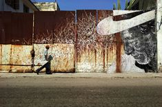 In May 2012, JR collaborates with Cuban-American artist José Parlá on the latest iteration of The Wrinkles of the City: a huge mural installation in Havana, undertaken for the Havana Biennale, for whi