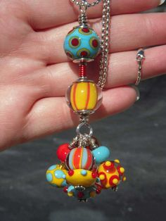 "Lampwork beads, necklace, primary colors, ""Joyful"". $125.00, via Etsy."