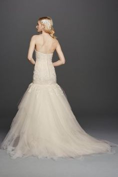 Love at first sight is what you will be feeling when you see this show-stopping strapless mermaid tulle wedding dress. Show off that hour glass figure you worked so hard for in this fitted gown featuring beaded embellishments, sweetheart neckline and a voluminous mermaid skirt with stunning hanky hem detailing. You won't be able to wait for your special day!  Oleg Cassini, exclusively for David's Bridal.  Also available inPetite, Plus Size, Extra Length and Plus Size Extra Length.