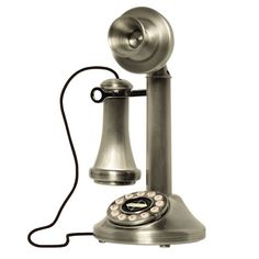 Candlestick-style phone with rotary-inspired dial.   Product: Candlestick telephone  Construction Material: Metal...Candlestick Telephone $54.95 $106.00