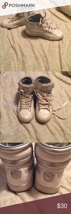 Puma HighTops size 7 Women's size 7. Cute white and silver high tops, in amazing condition! Add a little punk to any outfit with these awesome sneakers! Puma Shoes Sneakers