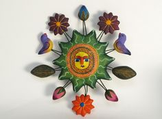 Handpanted green sun, with yellow face, Mexican decorative pottery wall art measures 4 inches wide. Ceramic Wall Art, Ceramic Decor, Mexican Wall Art, Mexican Ceramics, Yard Ornaments, House Signs, Sea Crafts, Sun Art, Sun Moon