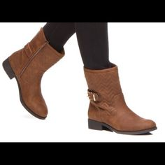 New Textured Booties This casual and make a statement new brown Bootie has never been worn and comes in its original box. The Bootie features a zig-zag textured look with a buckle accent and back zipper closure. The heel height is 1.25 inches and the shaft height is 7.5 inches. Shoes Ankle Boots & Booties