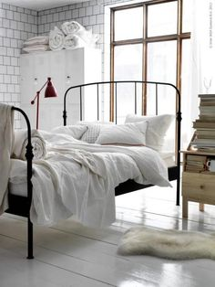 dreamy // wrought iron bed, tile walls, dark grout, sheepskin rug; light, moody bedroom