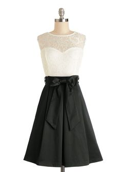 Nuanced Narrator Dress in Black. You perch on the tufted sofa in this satin-skirted, lace-topped twofer dress, excitedly listening to the radio play unfold.  #modcloth