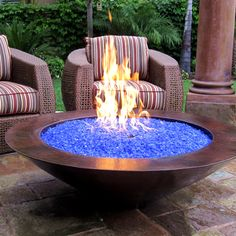 "48"" Essex Natural Gas Fire Pit Auto Ignition - Copper with blue fire glass - Fire glass is tempered glass manufactured in pebble-sized fragments used as a medium to retain and direct heat, usually in gas fireplaces and fire pits. Fire glass does not burn, but retains heat and refracts light as a result of burning gas. It comes in many colors but think how cool black glass would look at night."