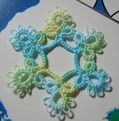 Stitches of Life II: Tatting ... moved the book pile around ...