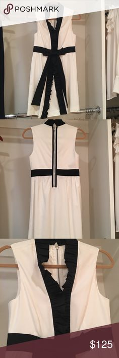 Alice & Olivia Party Dress Creamy white with black ruffle & bow detail. SO cute- you'll look like a little present.🎁 Perfectly new condition (lightly worn once). You will need a black camisole or maybe pin the ruffles. Alice + Olivia Dresses Mini