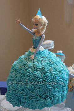 Coolest Elsa Doll Cake from the Disney Movie Frozen... This website is the Pinterest of birthday cake ideas
