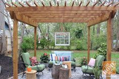 Repurposed items and mix-and-match give this pergola its fun bohemian style. Click through to see more of this delightful backyard makeover.
