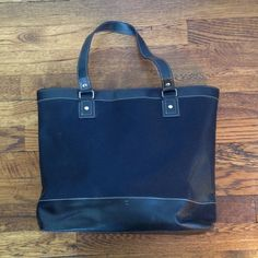 Large black tote Super roomy black tote. There is a zipper pocket inside and a hook for your keys. There are a few white marks towards the bottom (see picture 3 & 4) Bags Totes