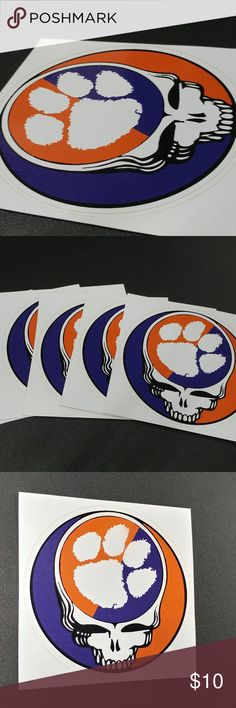 "Grateful Dead Clemson 5"" Sticker 2pk We have a ""Grateful Dead Shakedown Street Style""   2 pack Steal Your Face Clemson logo.   5"" vinyl indoor/outdoor Sticker   Opaque white backing allows for multiple placements, on light and dark surfaces.  Circle Die cut around outer edge of stealie to have graphic pop on any color surface   High quality Orajet vinyl allows for 5-7year placement when placed on any outdoor surface with water/UV proof substrate.  Car, Truck, Microbus, little red wagon etc.   Lifetime UV protection Oracal Ot"