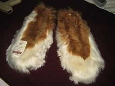 Dark brown and white cosy slippers, made of pure Suri alpaca fur