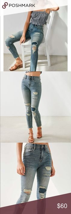 Urban Outfitters Cropped High-Rise Jeans Slashed + patched high-rise jean in our skinniest Twig fit with frayed cut-off ankles, by BDG. In soft power-stretch denim that contours the body with rips and whiskered fading for a vintage look with a contrast patch at one knee. Finished with 5 pockets and a button zipper fly. Only available at UO.  Content + Care - Cotton, polyester, Lycra - Machine wash - Imported Urban Outfitters Jeans Ankle & Cropped